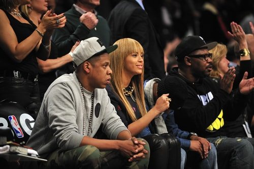 The Knowles' have bank. They sit courtside at games for the team they own.