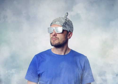 man wearing tin foil hat and tin foil glasses. conspiracy theorist. top 10 mysteries about the 9/11 terror attacks