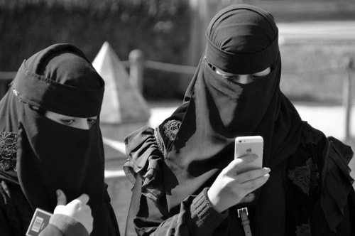 muslim women receiving text from Osama Bin Laden prior to 9/11 terror attacks. top 10 mysteries about the 9/11 terror attacks
