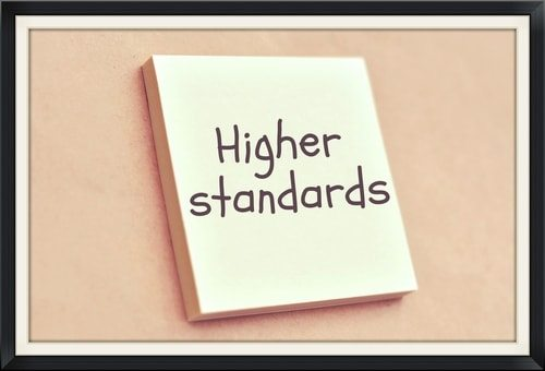 notepad with words higher standards.