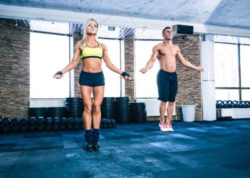 Man and Woman jumping rope.