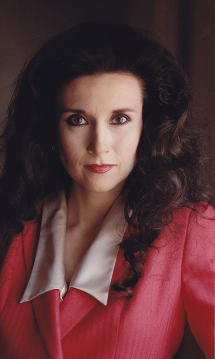 Marilyn Vos Savant. So smart and such a cutie! A double threat. At least!